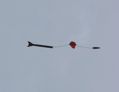 A moment later, the parachute has ejected and is beginning to inflate.  Photo by Greg Smith