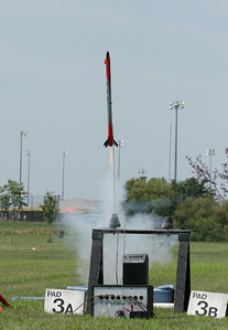 Mike Driskell's Estes Oracle video rocket lifts off with a D12.  Nice flight, if a little low.  Photo by Greg Smith