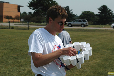 Pre-flight check of Mark and Adam Joseph's UFFO, an oddroc made out of styrofoam coffee cups.  Photo by Alan Carroll