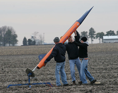 "Raising the ""Fighting Illini"" to launch position.  Photo by Greg Smith."