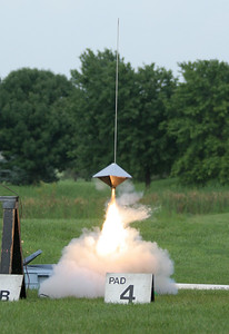 One of William Carney's many saucer-like rockets lifts off with an H motor.  Photo by Greg Smith