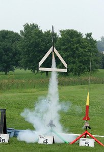 Laura Watson's Edmonds Aerospace Deltie Thunder glider lifts off with a D12 motor.  Photo by Greg Smith