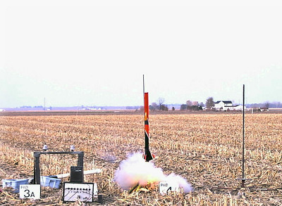 Ignition of Greg Smith's video rocket. photo by Christopher Brian Deem