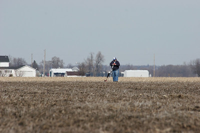 Chris picks up his NCR Big Brute from its landing spot in the muddy farm field.  Photo by Greg Smith