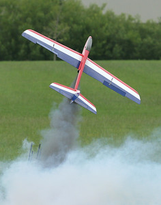 Dave Harris' Phoenix R/C glider lifts off -- slowly, and with a huge cloud of smoke -- on an F23 motor.  Photo by Greg Smith