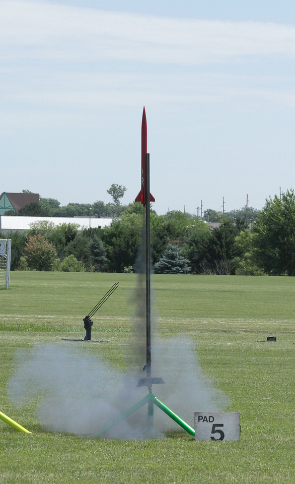 Greg Smith's bright red Aerotech Cheetah lifts off with a RoadRunner F60-7 motor.  The rocket landed far outside the park and was recovered hours later after a flight to 1763', as recorded by the altimeter onboard.  Photo by Greg Smith