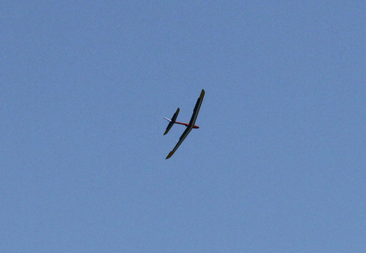 Dave Harris' Aerotech Phoenix rocket glider in radio-controlled flight, after a boost on an F23 motor.  Photo by Greg Smith