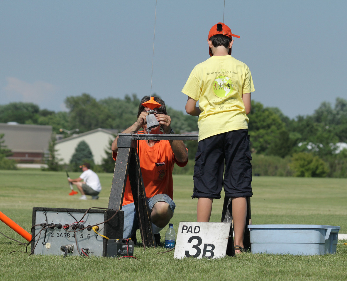 Rocketeers load their rockets on the pads.  Photo by Greg Smith