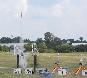 One Cub Scout rocket takes off, while two others wait their turn.   photo by Christopher Brian Deem