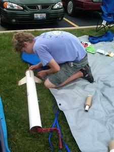 Adam continues to prep the EZI.  Mark Joseph photo.