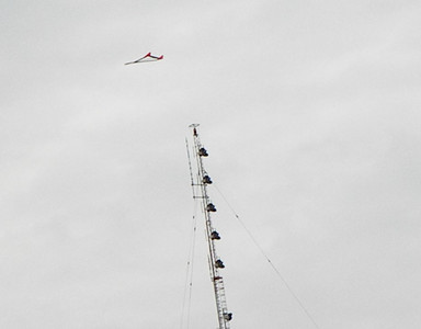 The glider is actually much closer to the camera than the radio tower. photo by Christopher Brian Deem
