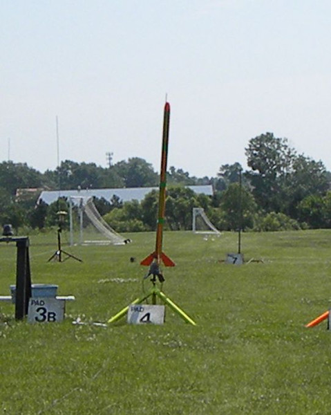 A scratch built three engine cluster rocket on 3 E9-6s.  photo by Christopher Brian Deem