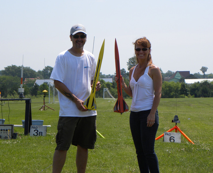 Mike and Shelia Zaborowski with their AeroTech Mustangs that they will try to drag race.  photo by Christopher Brian Deem