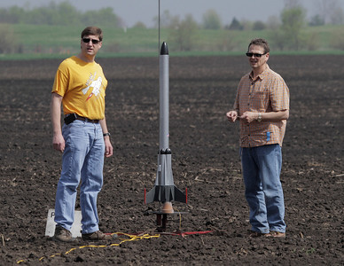 Mark Joseph and Gary Slater prepare to hook up Gary's Level II certification rocket, an upscaled Semroc Hydra, to fly from the far pad on a J350 motor.  Photo by Greg Smith
