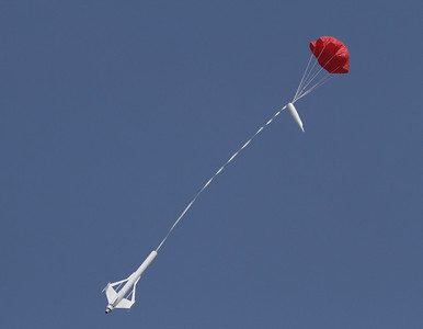 Recovery of Mike Z's Galactic Interceptor with a fully deployed parachute.  Photo by Greg Smith