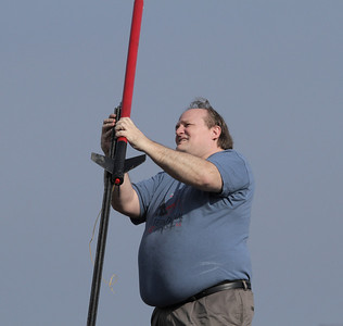 Lon Westfall loads his Hawk Mountain Transonic I on the pad, with an H170M-14 Metalstorm motor.  Photo by Greg Smith
