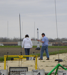 Gary Slater and his wife Shelia get ready to load Gary's Hydra upscale on the far pad. photo by Christopher Brian Deem