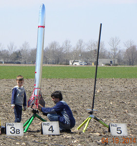A father and son with a Dude, an inflatable rocket on a D12-3. photo by Christopher Brian Deem