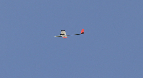 The Colibri R/C glider after burnout and starting to descend in a stable glide, making a wide turn to the left around the east side of the launch field.  Photo by Greg Smith