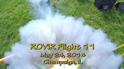 "Eleventh flight of the ROViR (Rocket Onboard VIdeo Recorder) model rocket payload system, May 24, 2014 at Dodds Park in Champaign, Illinois. Components included the 2.1"" diameter Helios-3 booster rocket, the ROViR-2 payload container with a Replay XD 1080 camcorder, and an Aerotech H128W-M motor. On this flight, the suspension lines between the two parachutes and the payload body twisted together after ejection, so the descent was very unstable. The video has been slowed to half of actual speed for more comfortable viewing. Video by Greg Smith"