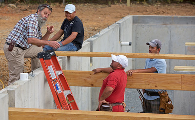 Stan Stutts was in charge of this homebuilding  project and here Stan is directing one of many great crews