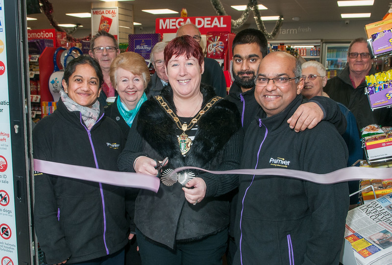 Test Valley Mayor Cllr Karen Hamilton cut the ribbon to officially open the revamped Saxon Fields Store with owners Mayur and Nilam Patel, their son Priyan and happy customers. Pic Andy Brooks - 3rd December, 2016.