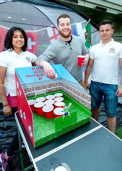Shey Barrett joins in the Beer Pong competition in Andover's Chantry Centre while on a visit to family in the area from Exeter with event organisers Ramandeep Chahal (left) and Chris Clifford. 4th June, 2016 - Picture Andy Brooks