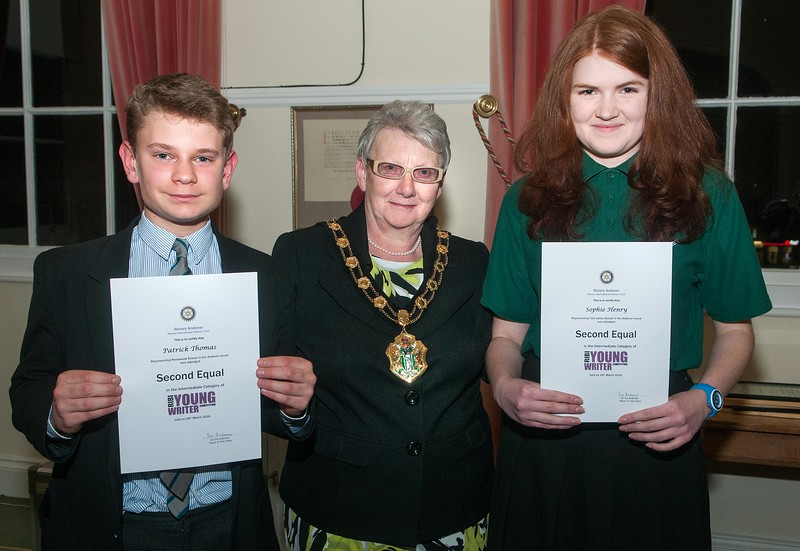 Test Valley Mayor Cllr Iris Anderson presents the Second Equal award certificates in the intermediate category of Rotary Andover Young Writer Competition to Patrick Thomas (left) and Sophie Henry. 16th March, 2016 - Picture Andy Brooks