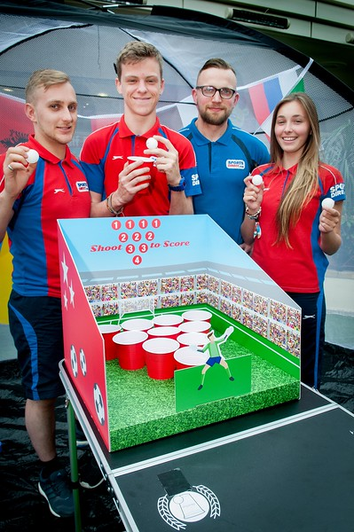 Sports Direct staff (l to r) Joe Foster, Adam Ferris, Chris Whitaker and Sophie Abraham all try their hand at the beer pong comepetition in Andover's Chantry Centre. 4th June, 2016 - Picture Andy Brooks