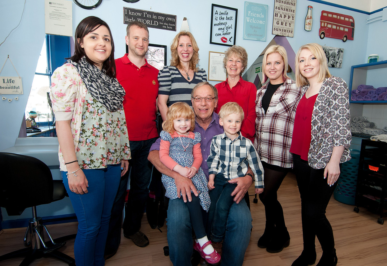 Celebrating 40 years in Business, Ron Wood of  A Cut Above hairdressers (seated) with grandchildren Grace and Oliver Wilkins. Also pictured are staff and family (l to r) Lauren Wlikins, Darren Wilkins, Zarra (correct 2 r's) Wilkins, Marcia Wood, Sheryl Wernham and Laura Cooper. 2nd April, 2016 - Picture Andy Brooks