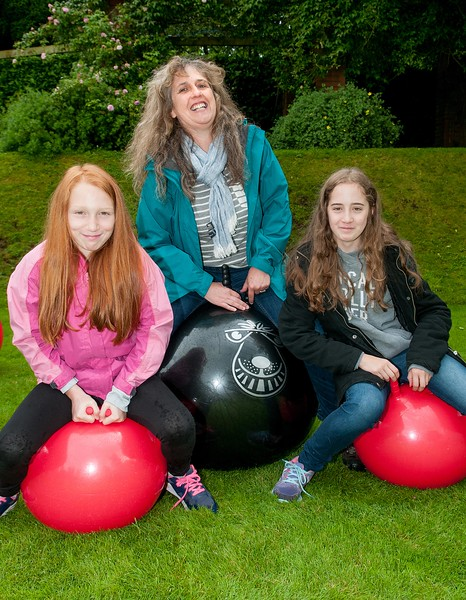 Bouncy Fun - Debbie Collis of Chilbolton and her daughters Bella (10, right) and Tasha (13), enjoy some spacehopper fun at the Chilbolton Church Fete. 25th June, 2016 - Picture Andy Brooks