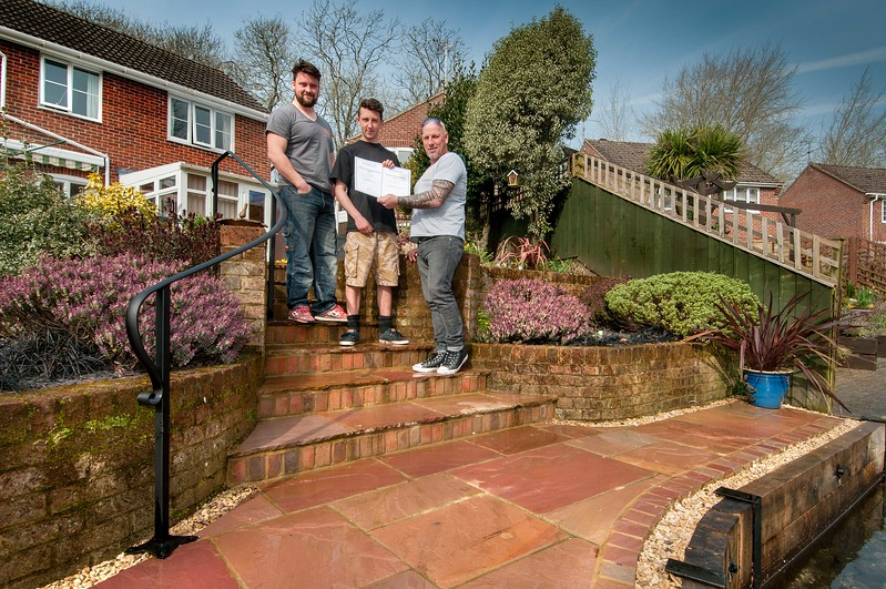 Award winning builder Andy Maclean (right) of Andover Groundworks with certificates and staff Adam Cope (left) and Ash Steele (centre) at a newly completed riverside build project in Andover. 12th March, 2016 - Picture Andy Brooks