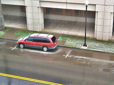 Hail on van parked on street.