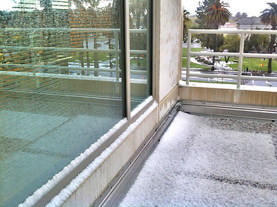 Hail on roof landing on County Government Building.