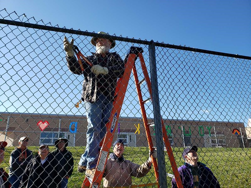 Rotarian Ralph Smith from the Rotary Club of Fort Collins; 1918, removing backstop fence.