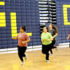 Some members of the GLT softball team warm-up before an indoor practice getting ready for opening games. SUN/David H. Brow