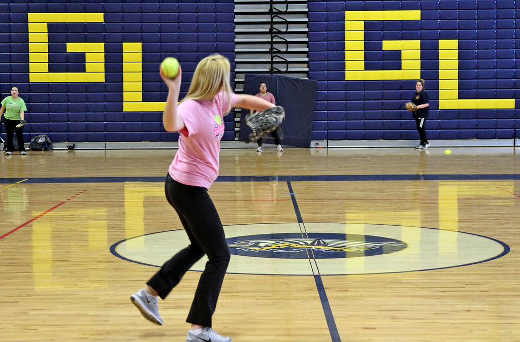 . GLT softball player, Jessica Lawler, in front, throws to awaiting team-mates during an indoor practice. SUN/David H. Brow