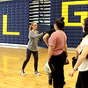 GLT softball assit., coach Nicole Tellier, on far left, gives tips to players during an indoor practice. SUN/David H. Brow