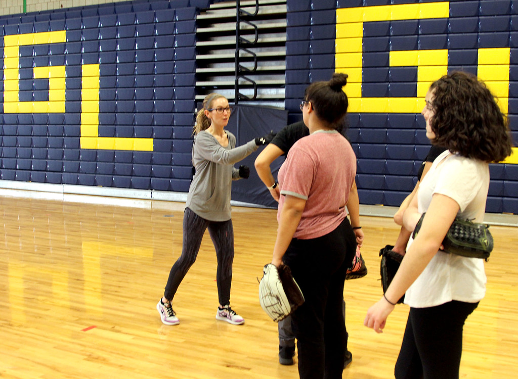 . GLT softball assit., coach Nicole Tellier, on far left, gives tips to players during an indoor practice. SUN/David H. Brow