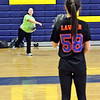 GLT softball team Capt. Stephaine Seymour, on left throws to returning veteran Nicole Lawler during a practice. SUN/David H. Brow