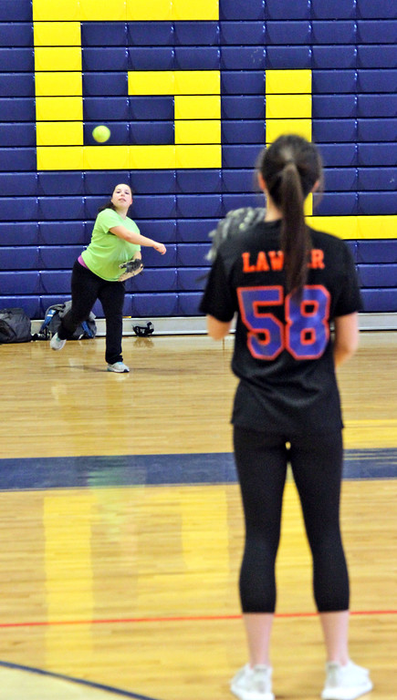 . GLT softball team Capt. Stephaine Seymour, on left throws to returning veteran Nicole Lawler during a practice. SUN/David H. Brow
