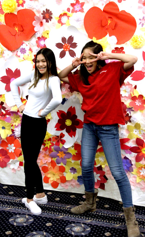 . Posing for pictures at the Photo Booth are local girls L-R, Kayla Nguyen,15 of Lowell and Thuy Nguyen,14 of Dracut, the girls are at the Vietnamese Lunar New Year celebration. SUN/David H.Brow
