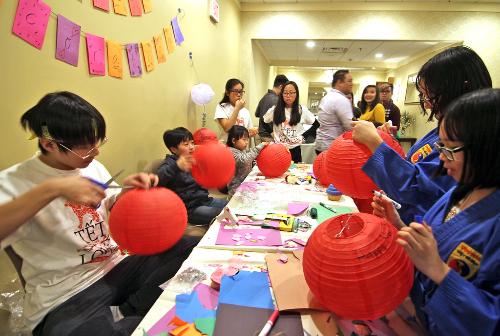 . Kids working on paper lanterns at the Vietnamese Lunar New Year Celebration. SUN/David H.Brow