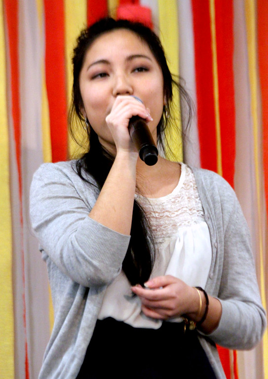 ". Here singing ""Best Mistake\"" is My-Ngan Tran, at the Vietnamese Lunar New Year Celebration. SUN/David H.Brow"