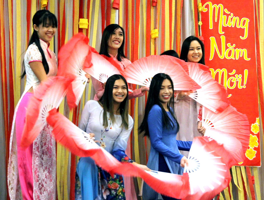 . Local students doing a Fan Dance as part of the fashion show for the Vietnamese Lunar New Year called TET at Lowell Celebration, dancers L-R front, Kayla Nguyen,15, of Lowell, Kimberly Nguyen,20 of Lowell, in back L-R, Sheila Vo,21, Kathleen Thai,20, and Mai Pham,19, of Lowell. SUN/David H.Brow