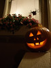 Our 1st carved pumpkin!  A traditional laughing jack-o-lantern face!  I tried to make it a vampire. I did this one first, to get the hang of carving again, before I tried the 2nd one of the cat and the moon and the stars.