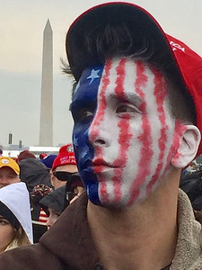 A young man from Missouri painted the U.S. flag on his face for the Trump inauguration. Photo by Dennis Kearns.