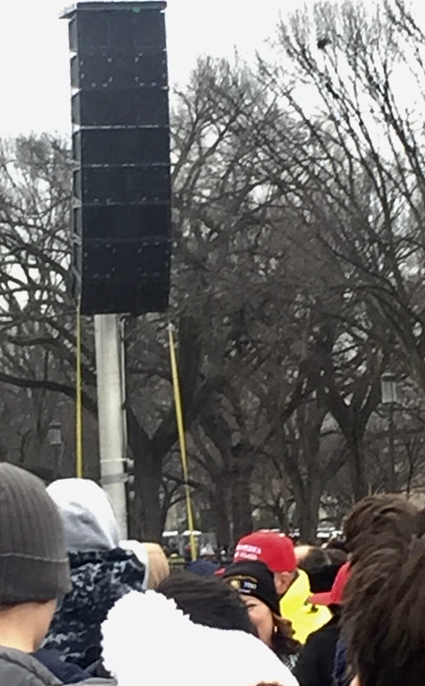 . Crowds are able to hear the music and speeches at the Trump inauguration through massive speakers set up in the National Mall. Photo by Dennis Kearns / Special to Digital First Media.