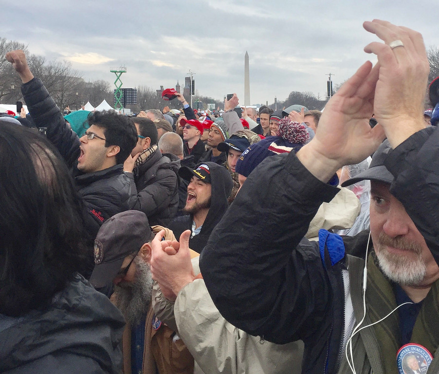 """. The crowd cheers \""""USA, USA,\"""" at Trump\'s inauguration Friday. Dennis Kearns / For Digital First Media"""