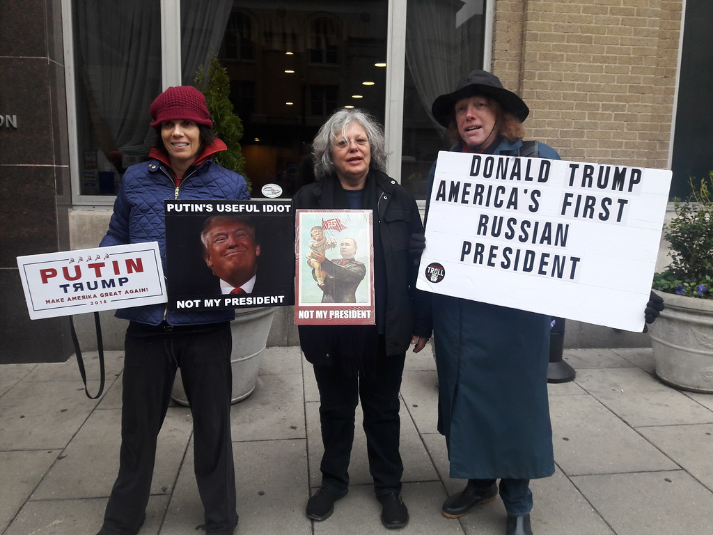 . Protesters at the inauguration. Photo by Bruce Fealk / For Digital First Media